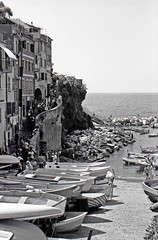 Only by sea (gio_artioli) Tags: analog analogic film pellicola rullino ilford fp4 riomaggiore 5terre liguria italy blackandwhite bn landscape sea boats nature zuiko om10 analogico vintage retro