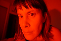 in the red (Fille.de.Lumière) Tags: red redspace redportrait brunette stare face redface browneyes ofme selfstudy selfportait selfie shadowsandlight inthered nofilter redlight selfexpression memyselfandi