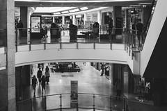 2019-07-13-130528_bw (Schmidtze) Tags: architektur berlin blackandwhite building einfarbig gebäude geschäft mensch olympusepl9 olympusm25mmf18 prenzlauerberg schwarzweis schönhauseralleearcaden stadt deutschland