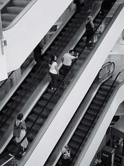 2019-07-13-130737_bw (Schmidtze) Tags: blackandwhite detail building berlin deutschland stair treppe staircase stadt architektur gebäude geschäft prenzlauerberg mensch einfarbig schönhauseralleearcaden schwarzweis olympusm25mmf18 olympusepl9