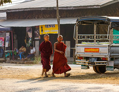 Buddhist monk walking on street (phuong.sg@gmail.com) Tags: alms asia buddhism buddhist burma burmese charity culture education ethnic handout indochina man mandalay monastery monk myanmar national nationality novice people portrait prayer red religion religious sacred school sightseeing social spiritual state street student study swarthy theravada tradition traditional travel yangon young zen