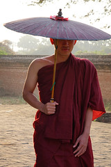 A young monk standing at Buddhist pagoda (phuong.sg@gmail.com) Tags: asia asian back bagan belief boy buddha buddhism buddhist burma burmese child cultural culture eastern ethnic monastery monk morning myanmar novice one outdoor people person pilgrimage poor portrait poverty rear red religion religious robe rural rustic single southeast street summer sunrise sunset temple tradition traditional view walking young