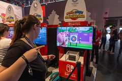 Young woman tests virtual archery sports of the video game Mario&Sonic at The Olympic Games, at the Nintendo Switch game station at Gamescom (verchmarco) Tags: köln cologne gamescom games computerspiele zocken 2019 messe gaming people menschen exhibition ausstellung shopping einkaufen landscape landschaft festival competition wettbewerb editorial leitartikel commerce handel woman frau street strase carnival karneval vehicle fahrzeug soccer fusball travel reise city stadt education bildung racecompetition rennenwettbewerb healthcare gesundheitswesen stock girl mädchen