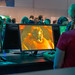 Games fair visitors play the Remake of Final Fantasy VII at Gamescom in Germany