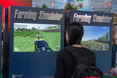 Female games fair visitor plays Farming Simulator by GIANTS Software at Gamescom (verchmarco) Tags: köln cologne gamescom games computerspiele zocken 2019 messe gaming competition wettbewerb landscape landschaft soccer fusball football championship meisterschaft racecompetition rennenwettbewerb recreation erholung festival vehicle fahrzeug people menschen dragrace track spur signal league liga election wahl travel reise action aktion building gebäude technology technologie exhibition ausstellung