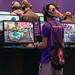 Gamer und Nerds in der EA-Area auf der Gamescom, beim spielen der Videospielserie Need for Speed