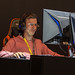 Man with AORUS headphones playing video games at Gamescom