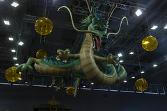 Dragonball Z Dragon Shenron figure hangs from the ceiling at games fair Gamescom in Germany (verchmarco) Tags: köln cologne gamescom games computerspiele zocken 2019 messe gaming energy energie festival light licht people menschen science wissenschaft color farbe hanging hängend lamp lampe man mann gold technology technologie travel reise flame flamme art kunst business geschäft robot roboter fun spas commerce handel industry industrie street strase