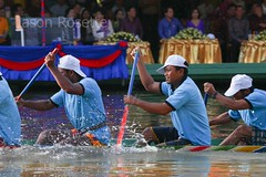 Light Blue Men's Boat Racing Team Paddles Past Dignitaries (jasonrosette) Tags: asia camerado jrosette jasonrosette cambodia festival water blue travel boat competition racing team river athlete rowing