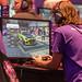 """Videospieler testen das Need For Speed """"NFS Heat"""" auf der Playstation 4, während der Gamescom"""