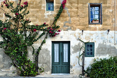 Faded Memories (Jocelyn777) Tags: architecture houses buildings facades doorsandwindows plants foliage stone stonehouses bougainvillea wardija malta travel