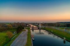 Schoorldammerbrug spanning the Noordhollandsch Kanaal. (Alex-de-Haas) Tags: adobelightroom aurorahdr aurorahdr2019 dji dutch fc6310 hdr holland n9 nederland nederlands netherlands noordholland noordhollandschkanaal p4p phantom phantom4 phantom4pro rc schoorldam schoorldammerbrug skylum warmenhuizen westfrisia westfriesland aerial aerialphotography air beautiful beauty bridge brug canal drone dusk kanaal landscape landschaft landschap lente lucht luchtfotografie polder quadcopter reflectie reflection schemer schemering skies sky spring sundown sunset water zonsondergang northholland