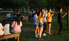 Let's Shoot the Sunset! (Anthony Mark Images) Tags: sunset trees goldenlight benches smiles cellphones cellphonephotographers youth youngadults guys girls shorts tshirts pants relaxing asian summercamp fairhavens trentcanal ontario canada brock people group portrait nikon d850 flickrclickx enthusiasm