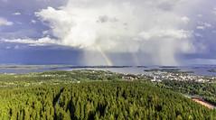 Rainbow and rain at the same time over a lake (VisitLakeland) Tags: finland kallavesi kuopio kuopiotahko lakeland puijo puijontorni clouds järvi lake luonto maisema nature outdoor pilvi puijotower rainbow rainy sadepilvi sateenkaari scenery weather