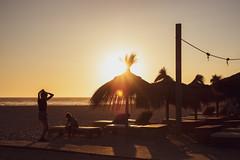 Sunset... (hobbit68) Tags: fujifilm xt2 holiday summer sommer sun sky sunset sonne strand sunshine sonnenuntergang spanien spain sonnenschein sand schatten shadows silhouette espania espana espanol espagne steg andalucia andalusien atlantik people menschen leute andalusisch küste beach playa sonnenschirm urlaub travel traveling meer ozean wasser water