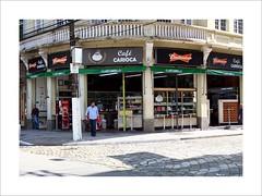 Café Carioca (W Gaspar) Tags: santos southamerica latinamerica street building café urban brazil brasil photoborder fujifilm finepix x10 geotagged man coffeestore downtown sidewalk old