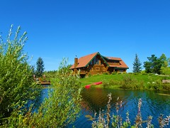 Home with a waterfront view in Alberta (Trinimusic2008 -blessings) Tags: trinimusic2008 judymeikle nature house alberta rural vacation peggyandted august 2019 today gratitude family bluebirdestates outdoors canada lake manmadelake water grass green leaves