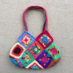 One side of the bag view C (crochetbug13) Tags: crochet crocheted crocheting crochetsquaresgrannysquares crochetpurse grannysquarepurse grannysquaretote grannysquarebag crochetbag crochettote scrapyarncrochet