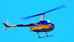 Gold And Blue Helicopter Flying Over Marina (stevblock) Tags: gold and blue helicopter flying over marina