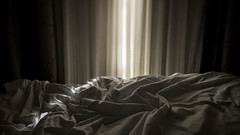 First light (romeos115) Tags: light shadow soft bed sheets sunrise sunset morning sun sunshine glow curtain shades alone quiet stillness restless monochrome bw
