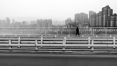 The day after (Go-tea 郭天) Tags: chongqing républiquepopulairedechine giant empty alone lonely man walk walking bridge skyline building huge river movement desert hat cap old lines street urban city outside outdoor people candid bw bnw black white blackwhite blackandwhite monochrome naturallight natural light asia asian china chinese canon eos 100d 24mm prime