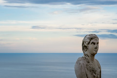 Beautiful statue from the belvedere, the so-called Terrazza dell'infinito, The Terrace of Infinity seen on the sunset, Villa Cimbrone, Ravello village, Amalfi coast of Italy (OLF Picture) Tags: statue statues terrazzadellinfinito terraceofinfinity seasunsetpanorama italy amalficoastitaly tyrrheniansea sunset ravellovillage town young lifestyle female rocks natural woman summer tourism vacation holiday beautiful coast ocean beach water nature sea sculpture religion sky stone asia angel ancient art monument travel architecture china old lion culture religious white god faith marble blue symbol