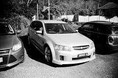 A Holden car wearing a Chevrolet badge (Matthew Paul Argall) Tags: zenit35f 35mmfilm blackandwhite blackandwhitefilm ilforddelta100 100isofilm car vehicle automobile transportation holdencommodore