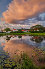 Pink clouds (Vest der ute) Tags: xt20 norway rogaland haugesund water waterscape houses reflections clouds sky evening foliage grass fav25