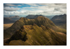 The Perfect Window (Augmented Reality Images (Getty Contributor)) Tags: hdr nisifilters beinnalligin beinndearg beinneighe bluesky canon cliffs highlands hiking hillwalking landscape liathach mountain munro ridge rocks scotland summer torridon vanguard