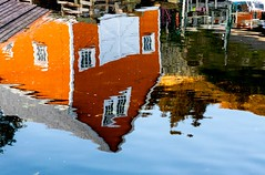 Water Shed (Karen_Chappell) Tags: water liquid ocean harbour orange blue shed reflection reflections quidividi stjohns newfoundland nfld canada eastcoast avalonpeninsula atlanticcanada windows sea atlantic canonef24105mmf4lisusm white