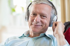 How Can Music Benefit Older Adults Who Have Alzheimer's? (hcadesmoines) Tags: senior seniors man listening music headphones wireless bluetooth indoors athome relaxing sitting sofa technology connected men male mature middleaged 60s sixties caucasian oneperson person people horizontal happy smiling audio enjoyment copyspace retired retirement portrait lookingatcamera unitedkingdomofgreatbritainandnorthernireland homecare seniorcare eldercare respitecare