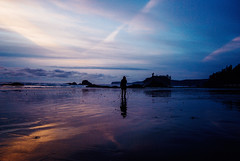we live for the quiet, intimate moments that mark not our calendars but our hearts (ewitsoe) Tags: washington state spring sea ocean coast rubybeach sunset woman tripod stillness quiet contemplative sun water motion nikon seaside erikwitsoe ewitsoe travel