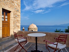 GREEK SUMMER (mary.th) Tags: monemvasia greece summer greek travel sky clouds sea church house door table chairs hotel cityscape