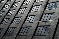 DSC_8787 geometry in architecture - Manchester (Filip Patock) Tags: geometry geometric architecture modern manchester lines black bricks facade elevation windows dark creative photography nikond3200 england uk