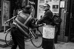 Please do not lock bikes here... (Silver Machine) Tags: london bricklane streetphotography street candid men argument bike securityguard blackwhite bw mono monochrome fujifilm fujifilmxt3 fujinonxf35mmf2rwr