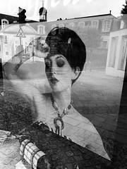 Don't look back... (Ageeth van Geest) Tags: reflection quotedon'tlookback shop window woman zwartwit monochrome blackandwhite bw sundaylights