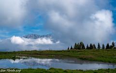 Tra le nubi fa capolino la Presolana (Gian Floridia) Tags: bg magnolini montepora presolana clouds nubi pond stagno songavazzo provinceofbergamo italy