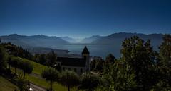 Overlooking Lake Geneva (CraDorPhoto) Tags: canon6d lake water landscape mist mountains outside outdoors switzerland sky blue