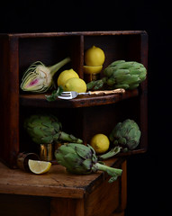 Compartments (njk1951) Tags: artichokes vegetables fruit citrus lemons woodenbox woodentable stilllife fork brassrings green yellow
