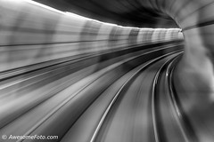 Passing Through the Tunnel of Time 2 (james c. (vancouver bc)) Tags: train underground subway black white blackandwhite tunnel motion blur railroad city car rail vancouver bc britishcolumbia canada speed fast flyover railway passing movement trail dynamic urban way zoom commute commuter drive moving skytrain outdoor perspective rapid route speedway town transport transportation travel velocity