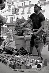 Gucci-ish belts street seller (sjnnyny) Tags: streetphoto nyc manhattan stevenj sjnnyny d750 afmicronikkor55f28 vendor midtown greeleysquare shopping candid