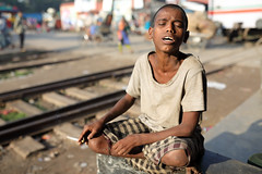 Bangladesh, homeless Rohingya boy in Dhaka (Dietmar Temps) Tags: abandoned alone asia bangladesh boy child cigarette culture developingcountry dhaka homeless homelessness kid loneliness male orphan outdoor people person poor poverty railwaystation railwaytracks refugee rohingya smoking streetchildren streetkids streetyouth urban urbancenter young