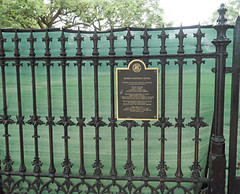 The house is gone, but the plaque has been restored to the fence - 2525 St. Charles Avenue, New Orleans, LA (Monceau) Tags: fence plaque emptyspace 2525stcharlesavenue neworleans louisiana