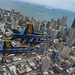 The U.S. Navy Flight Demonstration Squadron, the Blue Angels, diamond pilots fly over Chicago during the 2019 Chicago Air and Water Show.