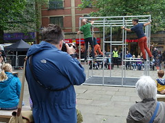 Photographer capturing Captive on the Flag Market, Preston (Tony Worrall) Tags: preston lancs lancashire city welovethenorth nw northwest north update place location uk england visit area attraction open stream tour country item greatbritain britain english british gb capture buy stock sell sale outside outdoors caught photo shoot shot picture captured ilobsterit instragram photosofpreston captive man photographer cage dance music fun climb snap candid people street