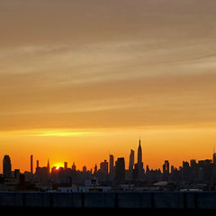 on our way (maximorgana) Tags: sunset thecity newyork backlight skyline empirestatebuilding