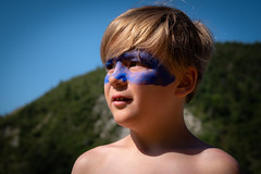 Blue boy with shadow cape (Janine en Ron) Tags: vakantie vacation vacances frankrijk france 2019 jongen 8yearoldboy child childhood fun funny kid outdoors outside playing summer browneyes mask colour face painting schmink