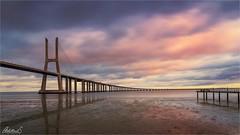 Sunset at Vasco da Gama bridge in Lisbon, Portugal (AdelheidS Photography) Tags: adelheidsphotography adelheidsmitt adelheidspictures portugal lisbon lisboa vascodagama bridge sunset clouds lowtide