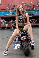 Motorbike (piotr_szymanek) Tags: portrait woman face studio skinny young monika monikat eyesoncamera bike legs garage longhair motorbike shorts 1k 20f 50f 5k 100f