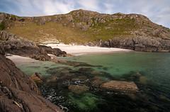 Mull beach (chris-parker) Tags: mull iona scotland beach rocks sand yacht sunset sea pinks seaweed sailing ship traigh ban boat rockpool puppy cal mac caledonian macbrayne